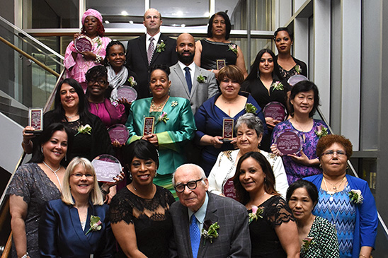 The honorees line up for a group shot behind UFT Family Child Care Providers Cha