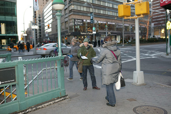 Members pass out leaflets in Manhattan. (Bruce Cotler)