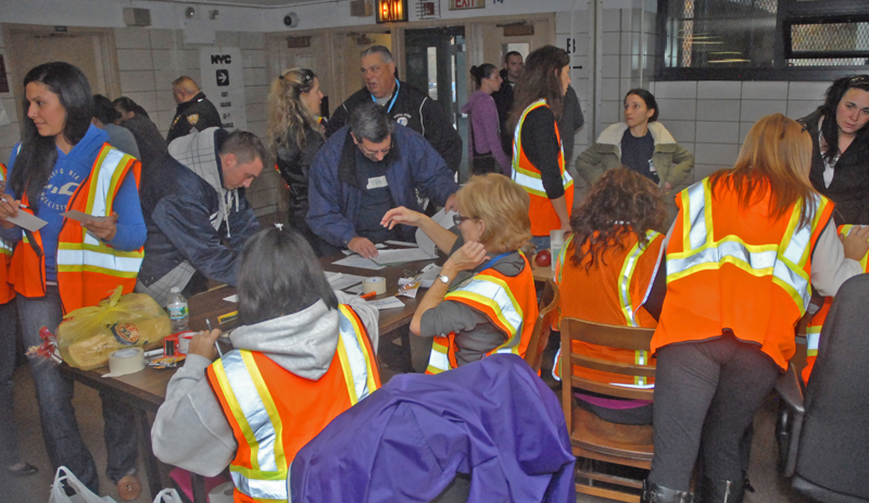 Things are hopping at the hurricane shelter at Tottenville HS on Staten Island, where UFT members and other city workers helped in whatever ways they could.