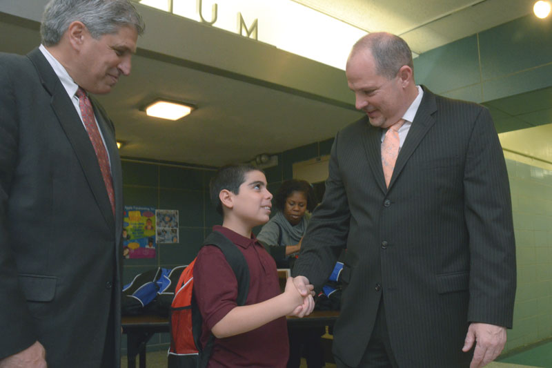 Mulgrew shakes hands with a 5th-grader, while City Councilman Domenic Recchia looks on. (Miller Photography)