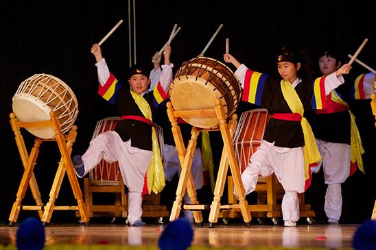 Students demonstrate traditional Korean Nanta drumming. (Miller