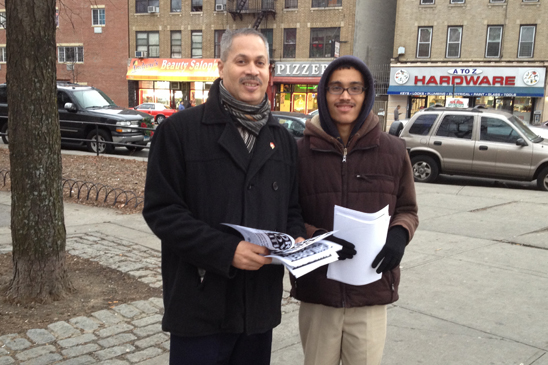 Eladio Cruz, Paraprofessional Representative from IS129 in the Bronx leaflets after school at the corner of Southern Boulevard and East Tremont in the Bronx.