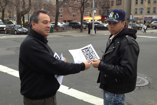 Louis Slattery, Chapter Leader from CS195 in the Bronx, leaflets after school at the corner of Southern Boulevard and East Tremont in the Bronx.