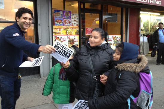 Oscar Gell, Delegate from CS211 in the Bronx, leaflets after school at the corner of Southern Boulevard and East Tremont in the Bronx.
