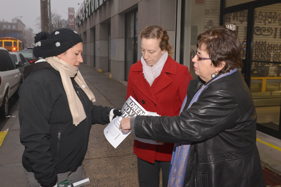 PS 239 parent Gloria Hernandez receives a flier from the school's chapter leader, Jeanne Gausman, and UFT District 24 Representative Rosemary Parker. (Miller Photography)