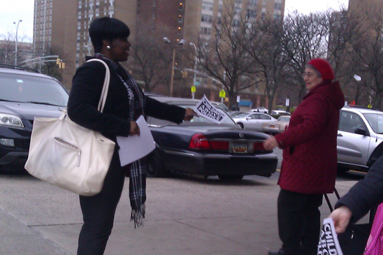 Marcia Julian from PS 346 in Brooklyn handing out fliers at Starret City.