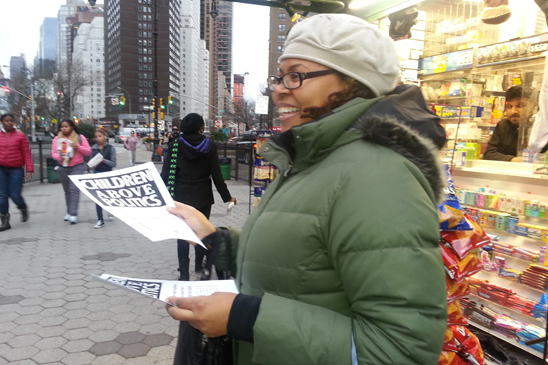 Veronica Lawyer hands out leaflets in Brooklyn. (Miller Photography)