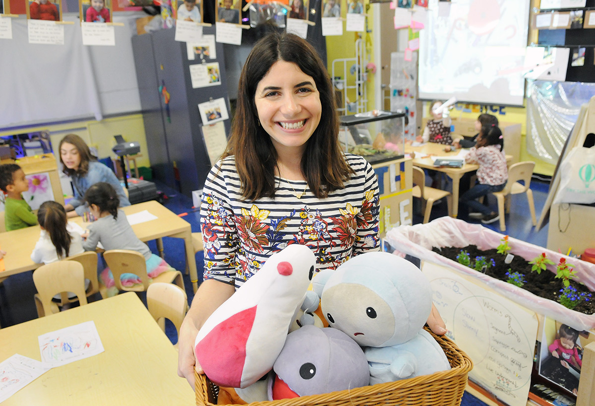 Fajgier shows off a basket of kimochi characters she uses to teach children abou