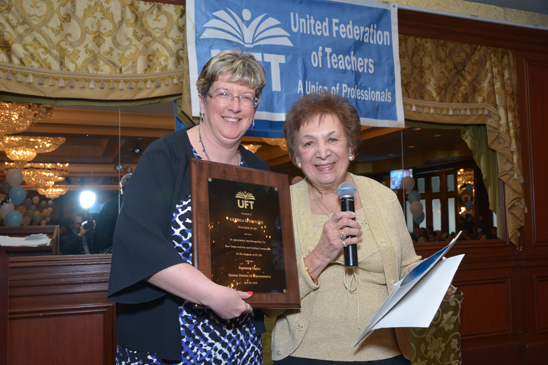 PS 229 Chapter Leader Loretta Tumbarello (left) with librarian Gloria Sfiroudis, an honoree whose years as a UFT activist that began on the early picket lines back in 1954. (Miller Photography)