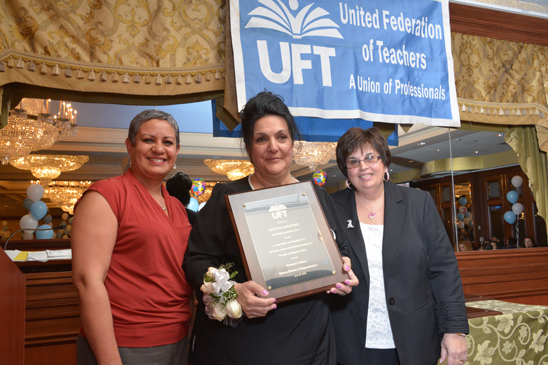 PS 91 Chapter Leader Rebecca Murphy (left) with paraprofessional Arlene Lomastro, an honoree, and District 24 Representative Rosemary Parker. (Miller Photography)