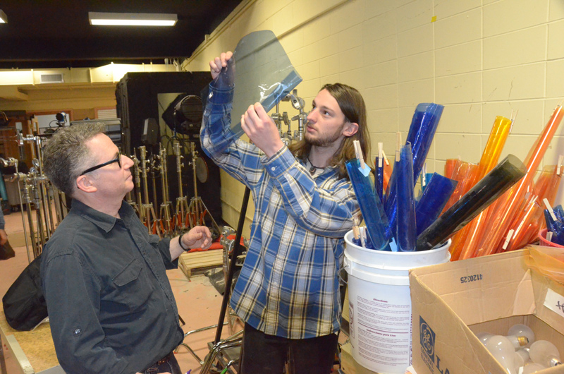 Student Justin Schneider (right) discusses a filter choice with Dimopolous' coll