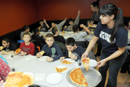 After the bowling there was pizza for everyone, as 5th-grade teacher Gabriella Vega handed out slices to the students. (Jonathan Fickies)