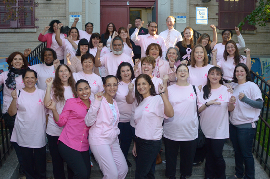 Members of the UFT chapter at PS 151 in Queens wear pink. (Miller Photography)