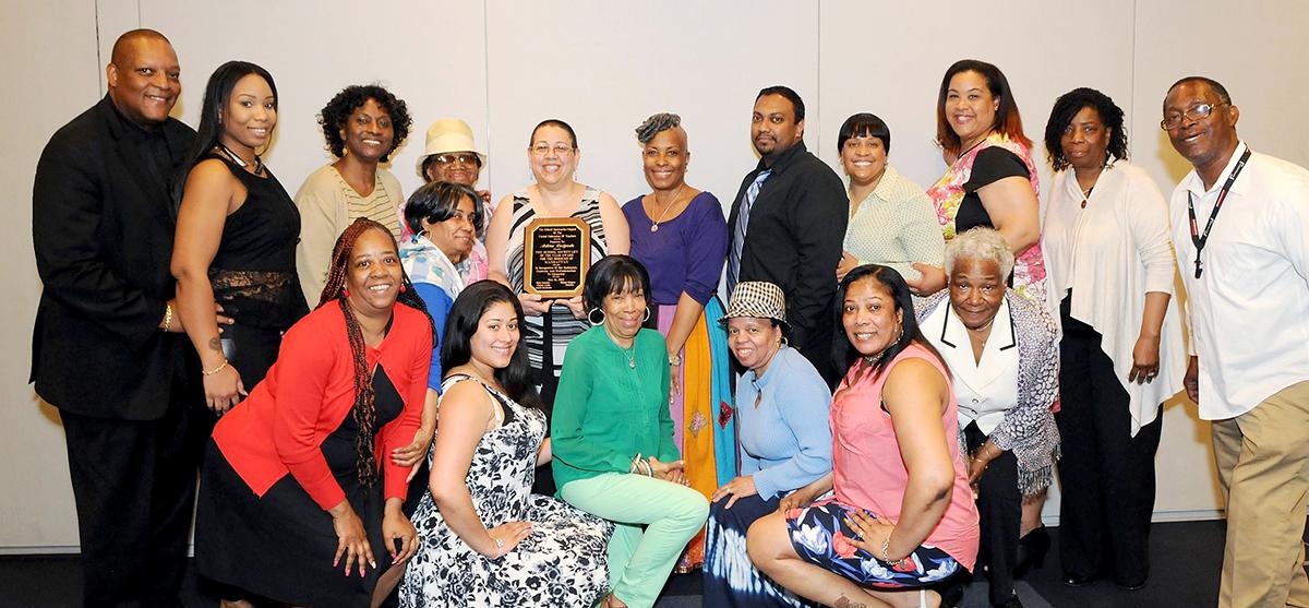 Manhattan Secretary of the Year Adina Delgado (center, holding plaque) with her