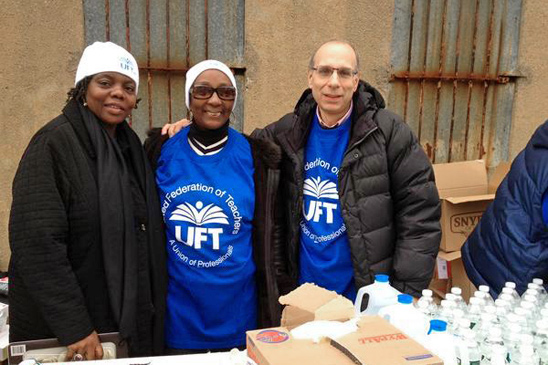 UFT volunteers Camille Eaddy, Julius Adams and Rev. Teresa Gaskin provide relief to Sandy victims in The Rockaways.