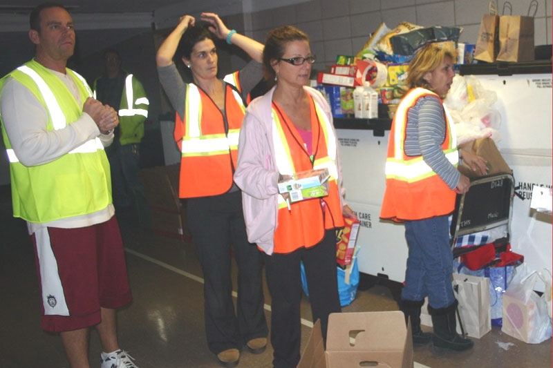 UFTers volunteering at the Tottenville HS evacuation center. From left: Guido Caligara, teacher at Grady HS, Brooklyn; Eileen Cappello, hospital instructor at Richmond University Medical Center; Dolores DeMaio, payroll secretary at PS 42, Staten Island. (Michael LoVerde)