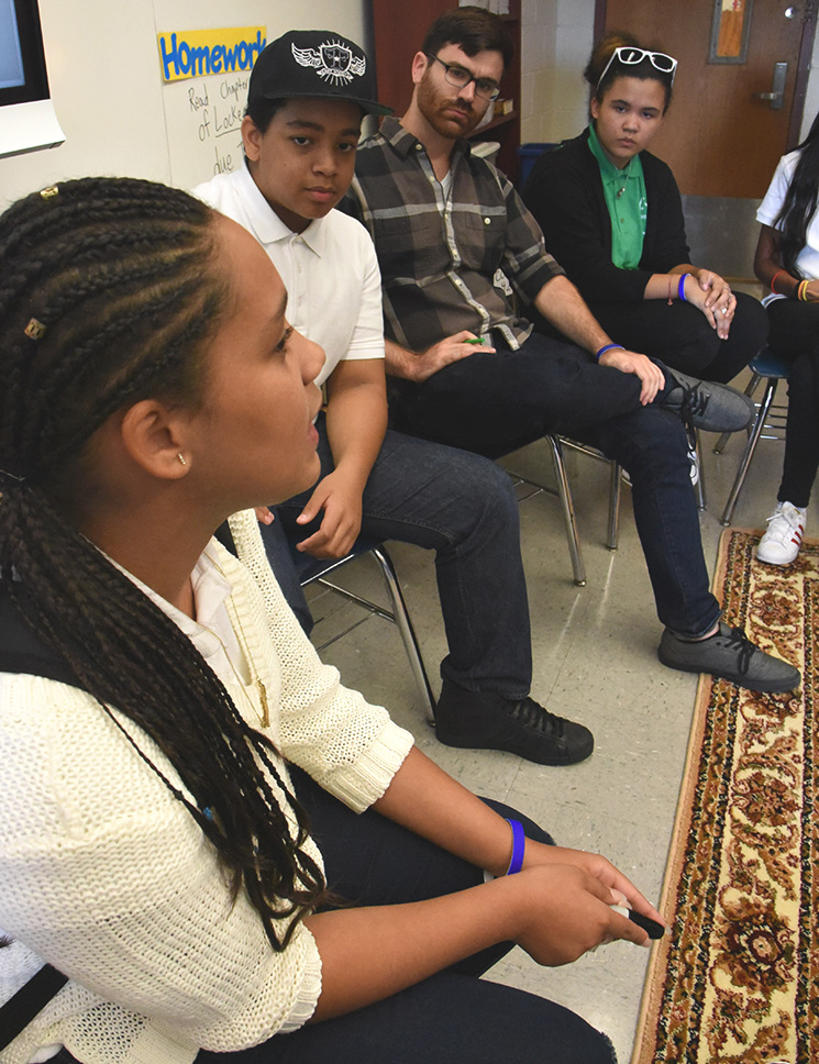 Alex Corbitt (second from right, top photo) listens as students in his Teen Acti