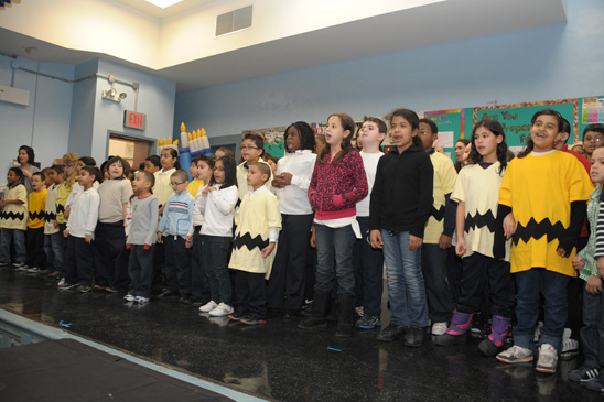 "The children, singing ""We Wish You A Merry Christmas,"" practiced for two months and aced concerts in the community and at school. (Miller photography)"