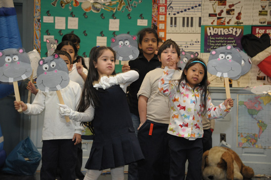 "Requesting an unusual gift, kids sing ""I Want A Hippopotamus For Christ (Miller photography)"