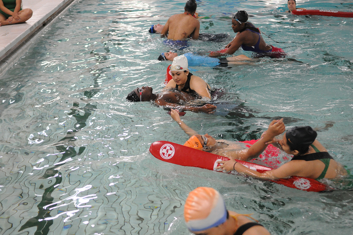 3bdcc66947fe Lifeguard certification program at Theodore Roosevelt Educational Campus.  Learning rescue and job skills. Students practice rescuing victims in  shallow ...