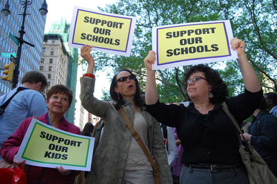 """The DOE website says 'Children First;' well, we've been devoting our lives to children, while the mayor has been devoting his life to making money,"" said Laura Daigen-Ayala (at right), at the rally with her colleagues from PS 48 in Manhattan. (Cara Metz)"
