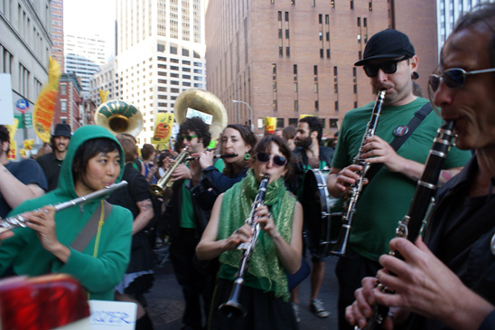 The Rude Mechanical Orchestra plays some rousing tunes to help keep protestors' spirits high. (Micah Landau)