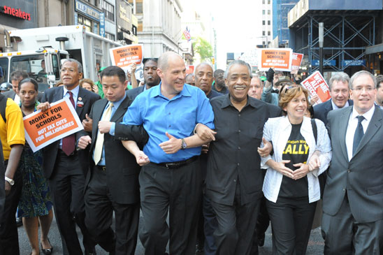 UFT President Michael Mulgrew, at center, leads the march to Wall Street. (Miller Photography)