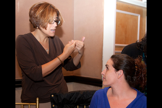UFT special education liaison Emma Mendez speaks with IS 302 special education teacher Laura Saccomanno. (Pat Arnow)