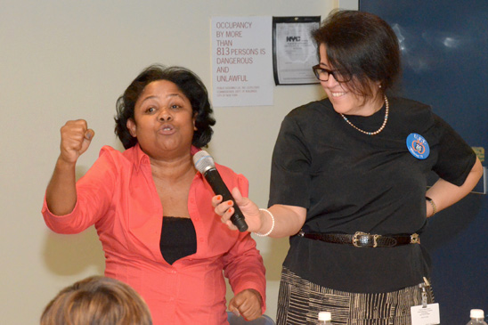 Esther Moreno of the Dr. Horan School, PS 79 in Manhattan, blasts the Teacher Effectiveness Program as District 75 Representative Analia Gerard holds the microphone. (Miller Photography)
