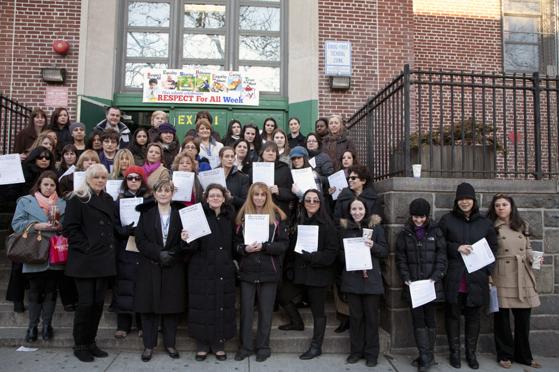 The staff at PS 11, Queens, stands united against the confusing, inaccurate repo