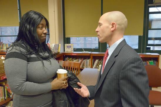 UFT District 18 Representative Rich Mantell speaks with teacher Aneesah Stewart. (Miller Photography)