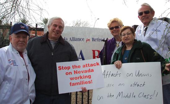 Retired Teachers Chapter Las Vegas Section Coordinator Richard Miller (left), a