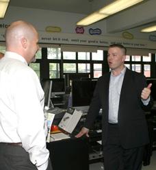 Music teacher Pete Pauliks shows Mulgrew around the school's state-of-the-art mu