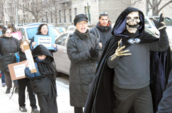 "The ""Grim Reaper,"" parent Linwood Harcum, leads 100 protesting parents in their"