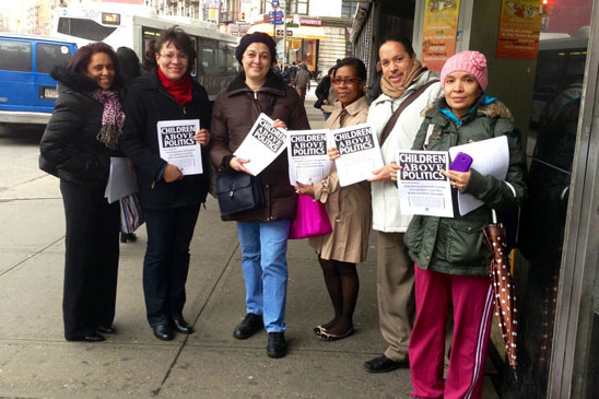 The staff at PS 115 in Manhattan get ready to leaflet at the George Washington Bus Terminal after school.