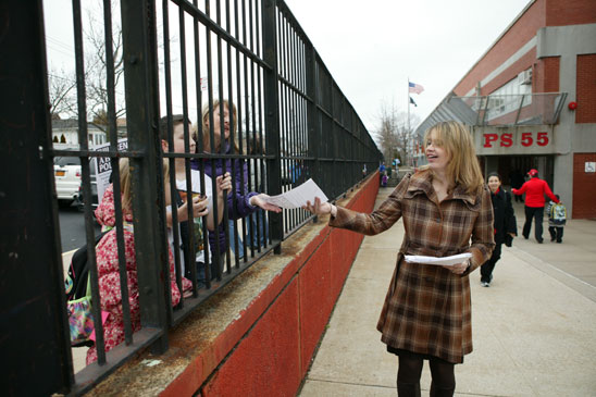 Co-chapter leader Courtney Gill hands out leaflets at PS 55 on Staten Island. (Bruce Cotler)