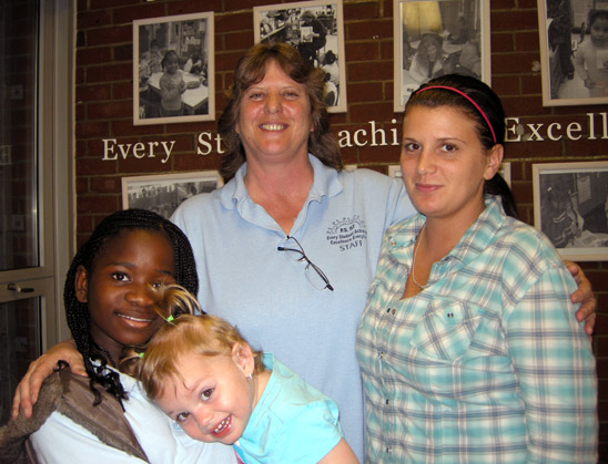 Education is all in the family for Patricia Lockhart (center), science teacher a