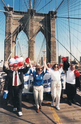 Randi Weingarten leads marchers across Brooklyn Bridge for a May 12, 1999 rally
