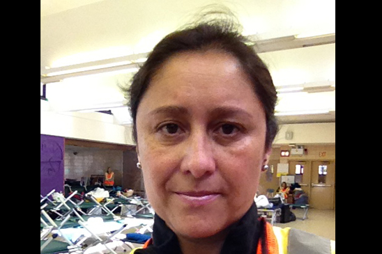 Adriana O'Hagan, the chapter leader at KAPPA V - MS 518, volunteers at the hurricane shelter in Tottenville HS on Staten Island.
