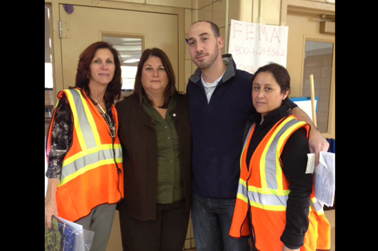 Assistant Principal Kathy Driscoll, special ed teacher David Schwartz and Chapter Leader Adriana O'Hagan of MS 518 volunteer at Tottenville HS, which gave shelter to hurricane evacuees.