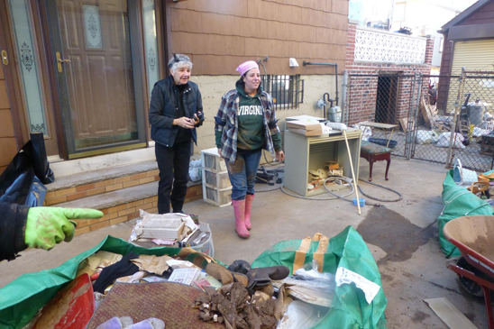 Lisa Cardieri (right), a nurse at Staten Island Hospital and a member of the Federation of Nurses/UFT, gets help cleaning up her storm-ravaged house from Federation of Nurses/UFT representative Kate Lombardi, a Visiting Nurse Service nurse, and other fellow nurses.