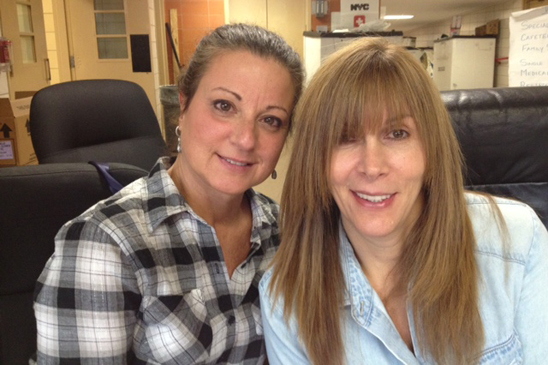 Dolores Demario of PS 42 and Lori Bracco of Tottenville HS volunteer at Tottenville HS, which gave shelter to hurricane evacuees.