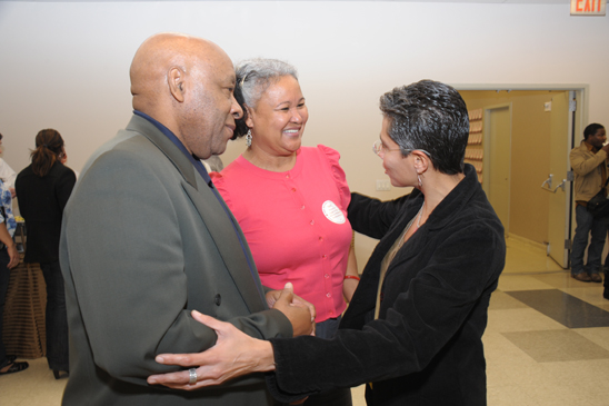 Guidance Counselor Chapter Chair Rosemarie Thompson (right) greets Wilfred Joseph, a guidance counselor at International School for Liberal Arts, and Maria Joseph, a guidance counselor at Discovery HS. (Miller Photography)