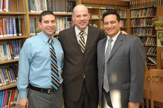 Mulgrew, Chapter Leader Ken Weinberg and Queens UFT representative for high schools James Vasquez trying to decide which books to check out of the library.