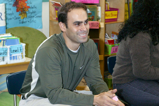 Teacher George Kakalos had his hand up to ask a question and appears satisfied with the answer.