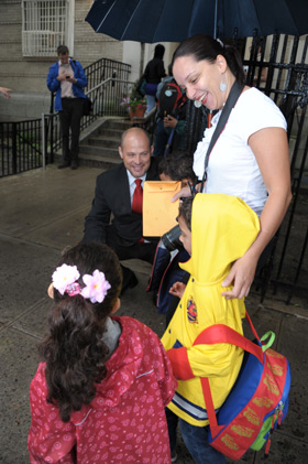 UFT President Michael Mulgrew helps welcome children on the first day of school