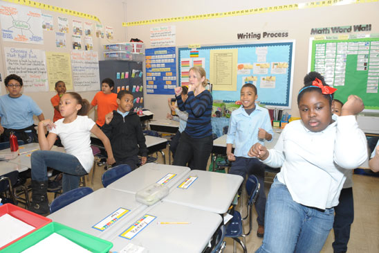 It's elbow to knee to start the day in Bernice Patten's 4th-grade class.