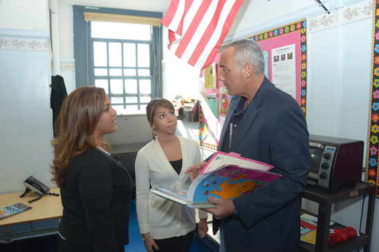 Sharon Dror (left) and Marisa Castro (center), teachers at host school PS 212, speak with early childhood educator Scott Krivitsky, relocated from PS 188. (Miller Photography)