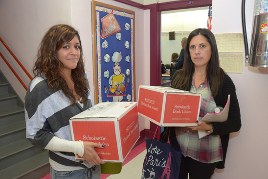 Michelle DiBlasi and Heather Battaglia from PS 212 in Brooklyn prepare for the influx of students from PS 188. (Miller Photography)