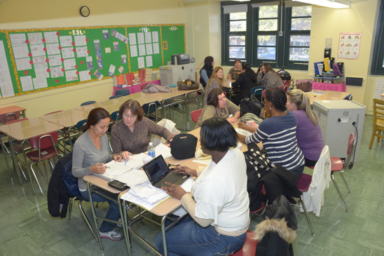 Teachers from IS 281 work together to prepare for the arrival of displaced students from PS 188 in Coney Island. (Miller Photography)